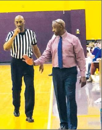 Gazette photo by BYRON AVERY UCA head basketball coach Bobby Joe Douglas always has a word of encouragement for his players, and the officials. Douglas, a Marion High School alum, is now a LHSAA Hall of Famer.