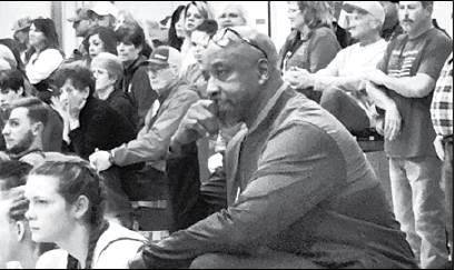 Gazette photo by BYRON AVERY UCA coach Bobby Joe Douglas takes a seat on the bench during a recent game.