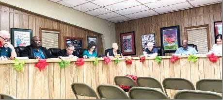 Gazette photo by BYRON AVERY Members of the Farmerville Town Council heard results Monday by auditors from Garrett and Garrett, CPAs, regarding the town's recent audit.