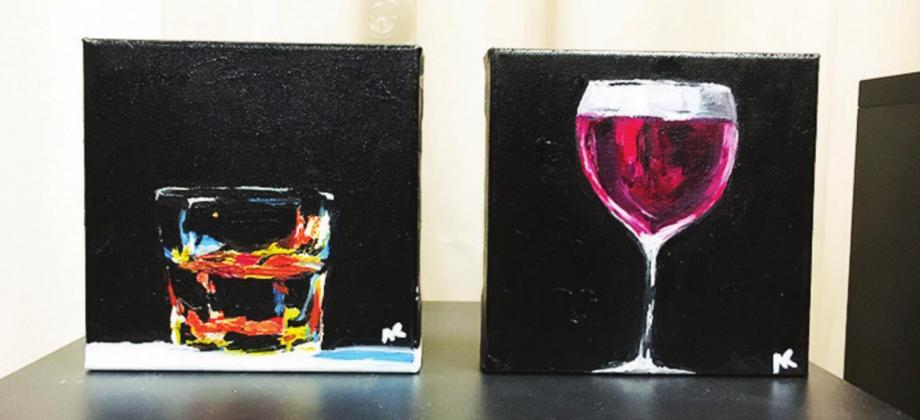 "Two pieces of art in Nicole Ramsey's ""Pick Your Poison"" series which features different alcoholic beverages in Ramsey's signature ""impressionistic"" style. ""Pick Your Poison"" was inspired and created during the 2020 pandemic. Gazette photos by Charlette Hilton"
