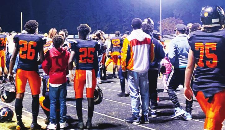 Farmer players celebrate and visit with family and friends following the team's 48-18 win over Carroll. The win clinched a district championship for the Farmers. Gazette photo by Byron Avery