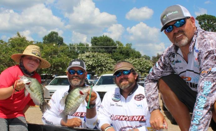 Crappie Masters teammates Shannon Porter, left center, and Jason Thomas show off some Ouachita River crappie while talking to fellow competitors Brian Young, right, and Diesel Byrd, left. Submitted photo