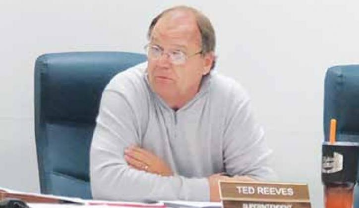 UPSB School Superintendent Ted Reeves listens to reports during Monday's school board meeting. Reeves turned in his resignation letter during a latter portion of the meeting. Gazette photo by BYRON AVERY