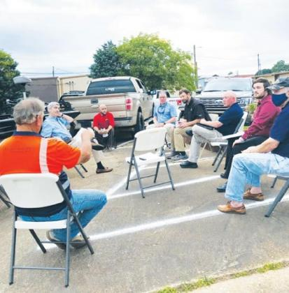 The D'Arbonne Lake Commission held it's most recent meeting outside in order to comply with social distancing guidelines. Gazette photo by BYRON AVERY