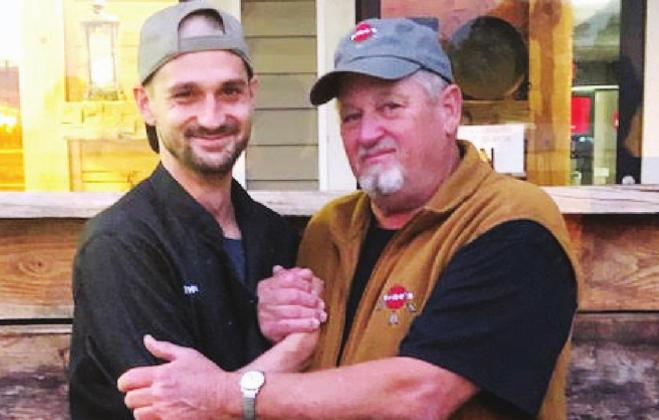 Colby Rushing (left) and father-in-law David Chrisman have bonded with each other as they and their family have worked together to open Tribe's Restaurant, a dream that was a long time in the making. Gazette photo by Charlette Madden